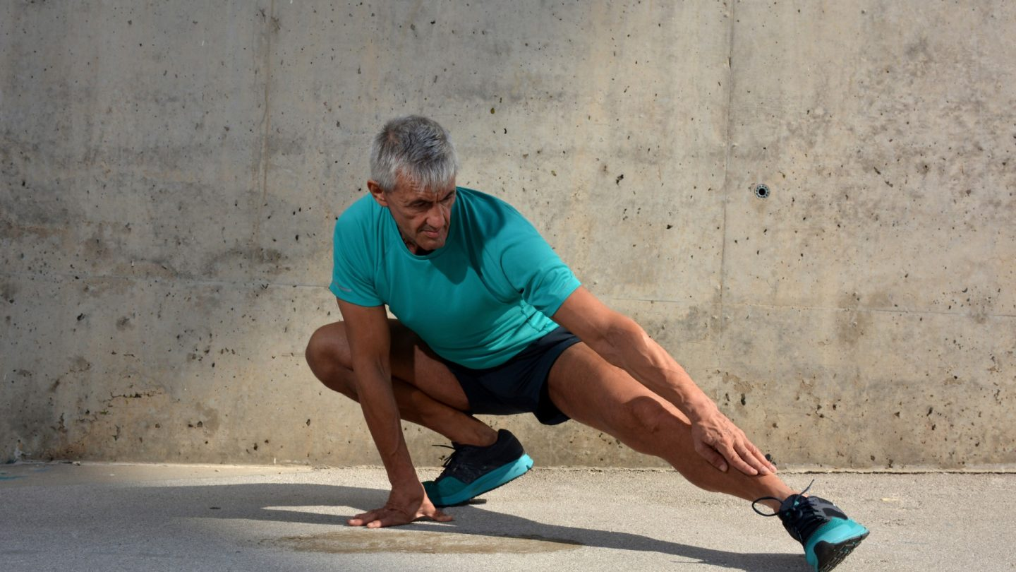 Older man practicing stretching